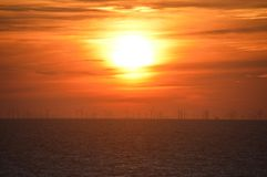 A sea windfarm at sunset Royalty Free Stock Image