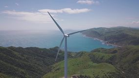 Wind Farm On Seaside Cliff, 4k Aerial Footage. Clean green energy generations, 4k aerial footage on cliff lines stock video footage