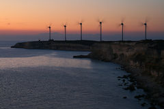 Wind farm silhouette Stock Images
