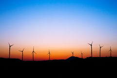Wind farm silhouette in sunset light. Royalty Free Stock Photo