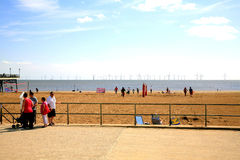 Wind farm, Skegness, Lincolnshire. Skegness beach on a summer's day with a large wind farm out to sea. Skegness, Lincolnshire, England, UK Royalty Free Stock Photos