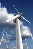 Wind farm with sky and clouds. Wind power plants with sky and clouds in the background, dramatic perspective Stock Photos