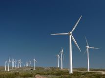 Wind farm in Spain 1. Wind Turbines under Beautiful Blue Sky in Spain. One turbine stands out from the others royalty free stock image