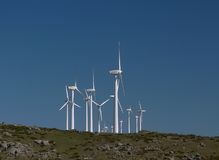 Wind farm in Spain 3. Wind Turbines on a Hill in Spain with a beautiful blue sky Royalty Free Stock Image
