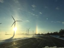 Wind farm sun dog. Sun dog behind windmill Royalty Free Stock Photos