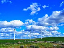 Wind Farm with Sunny Blue Sky. Rolling green hills with wind turbines and a blue sky with fluffy clouds, Oregon, United States of America Stock Photos