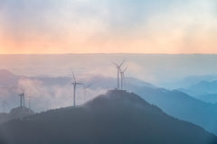Wind farm in sunrise Stock Images