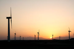 Wind farm after sunset. In desert Stock Photo