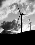 Wind farm, turbines against dramatic stormy sky with birds. Blac Royalty Free Stock Image