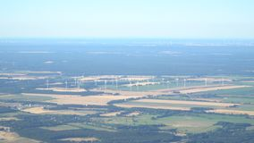 Wind farm of wind turbines from airplane stock footage