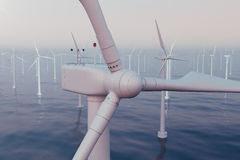 Wind farm turbines caught in sunset sky. Beautiful contrast with the blue sea. ecological concept. 3d rendering Royalty Free Stock Photography