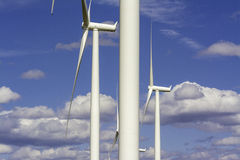 Wind farm turbines parts and puffy clouds Stock Photo