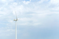 A wind farm in the wide spread field Stock Photos