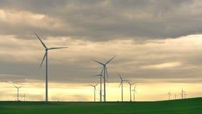 A wind farm of wind turbines creating green energy. Wind turbines clean energy, protection of nature stock video