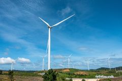 Wind farm. Wind turbines generating electricity. energy conservation concept stock photos