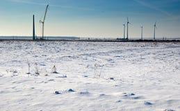 Wind farm in winter. Scenic view of wind farm turbines in snowy winters landscape stock photos