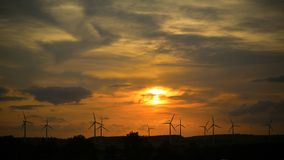 Wind farms against sunset Royalty Free Stock Photo