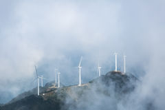 Wind farms in the misty clouds Royalty Free Stock Photos