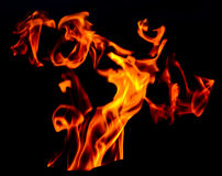 Wind of fire. Gas fire on the wind. Pay attention to \'faces\' at the up/left part of photo Royalty Free Stock Photography