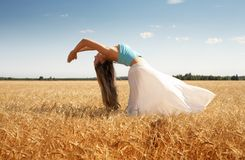 Wind. Fit girl at the field Royalty Free Stock Photo
