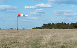 Wind flag windsock. On the background of blue sky airport Royalty Free Stock Image
