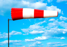 Wind flag windsock. On the background of blue sky airport Royalty Free Stock Photo