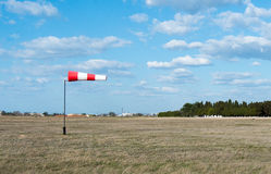 Wind flag windsock. On the background of blue sky airport Stock Photos
