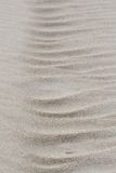 Wind formed sand texture. Vertical texture of a wind formed sand pattern Stock Images