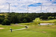 Wind generation on the sky line and golf course Stock Photography
