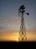 Wind generator. Wind turbine farm over sunset Royalty Free Stock Images