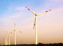 Wind Generator. Various clean energy is the rise of China, which is under the sunset of wind generators Royalty Free Stock Photo