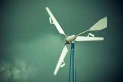 The wind generator. The outdoor wind generarator before dramatic sky stock photography