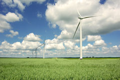 Wind generator on a background of the blue sky. Royalty Free Stock Photos