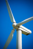 Wind generator, on a background of blue sky. Royalty Free Stock Images