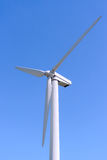 Wind generator, on a background of blue sky. Royalty Free Stock Photos