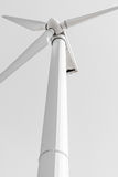 Wind generator, on a background of blue sky. Stock Photography