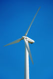 Wind generator, on a background of blue sky. Stock Photo