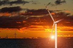 Wind generator on a background of sunset sky Stock Photo