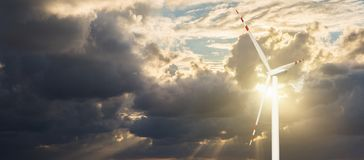 Wind generator on a background of sunset sky Royalty Free Stock Photos