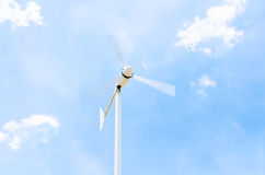 Wind generator on Cloudy sky. Cloudy Stormy sky with Wind generator working on the field Royalty Free Stock Photography