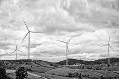 Wind generator with cloudy sky. Black and white Stock Photos