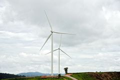 Wind generator with cloudy sky. Thailand Royalty Free Stock Images