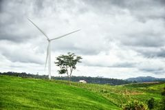 Wind generator with cloudy sky. Thailand Stock Image