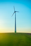 Wind generator on the green field Stock Images