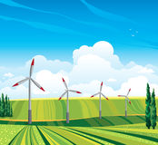 Wind generator and green meadow. Wind generator and green meadow on a blue sky with clouds. Summer rural landscape Royalty Free Stock Image