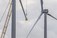 Wind Generator Maintenance. Workers performing maintenance and repairs to windmill blade Royalty Free Stock Photo