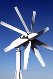 Wind generator on the roof of the office. against the blue sky. Energy savings. Saving features electricity.  Stock Photos