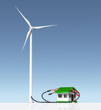 Wind generator supplies a small house. Front view of a wind generator that is supplying energy to a small house with two terminals connected on the roof. On a Royalty Free Stock Photos