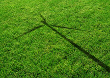 Wind Generator Turbine Shadow on the Grass Royalty Free Stock Photo