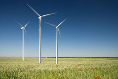 Wind generator turbine on spring landscape Royalty Free Stock Image